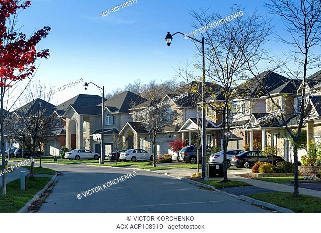 Street of detached single family detached middle-class houses in Canadian suburbs