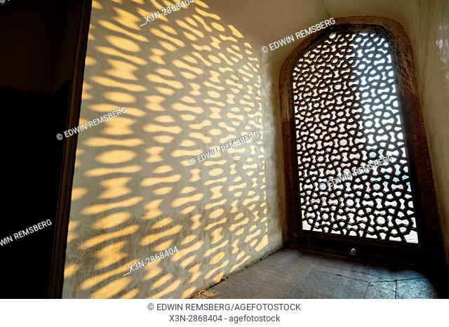 Jali stone, made with ornate geometry, is placed over a latticed screen that faces west, towards Mecca, inside Humayun's tomb