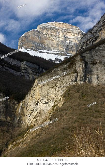 Waterfall and mountain peak, Dent de Crolles, near Grenoble, Massif de La Chartreuse Mountains Regional Natural Park, Isere, France, winter