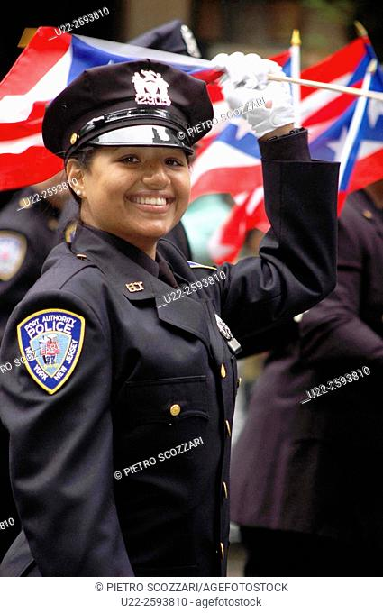USA, New York, New York City, Police Woman, of Puerto Rican Origins, at the Puerto Rican Parade along the Fifth Avenue