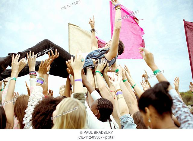 Man crowd surfing at music festival