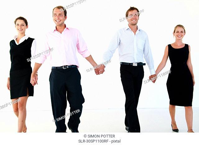 Confident walking business team