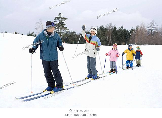 Family skiing, making a line