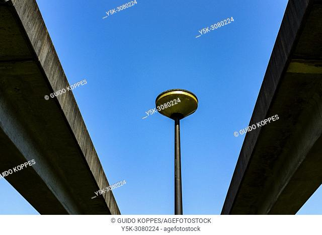 Amsterdam, Netherlands. Elevated Subway Track and StreetLight under a blue, spring sky