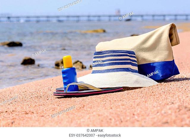 ed1e5e5881847 Beach gear on the sand overlooking the sea with a sunhat