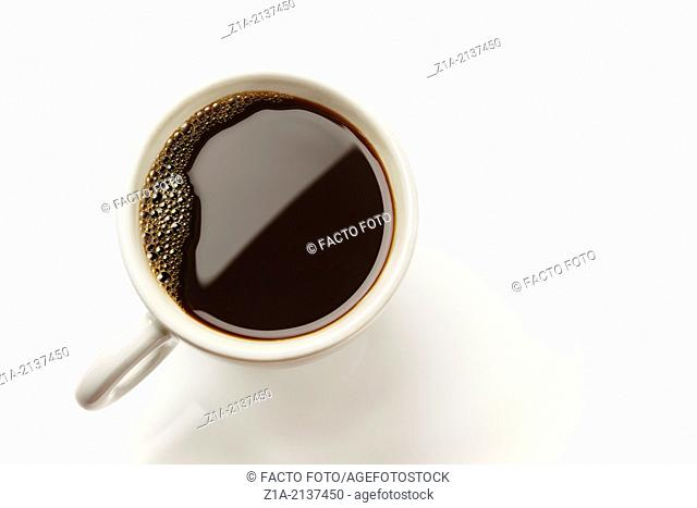 Top view of a white cup of black coffee on a white background