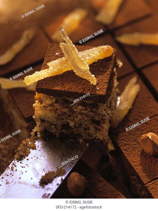 Chocolate & ginger squares with candied ginger on knife (1)