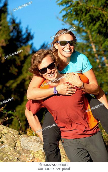 Hikers playing piggyback