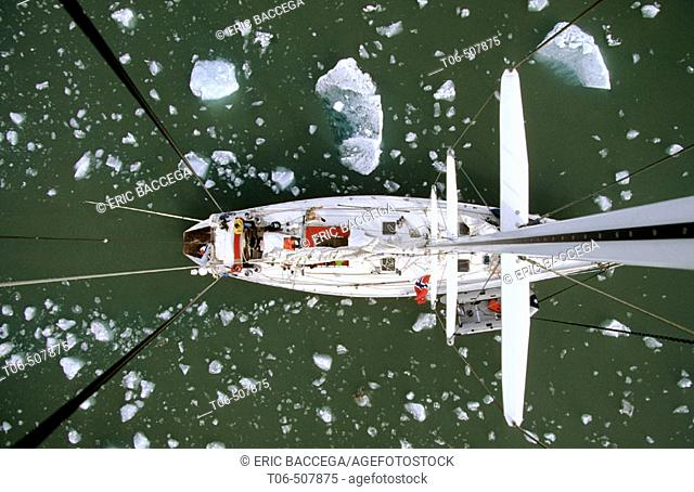 View down from top of mast to deck of sailing boat passing iceberg, King's Bay, Svalbard, Spitzbergen, Norway