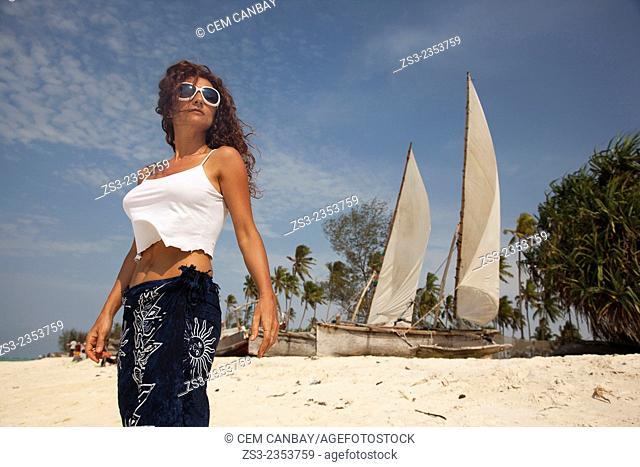 Woman posing at Nungwi beach, Zanzibar, Tanzania, East Africa