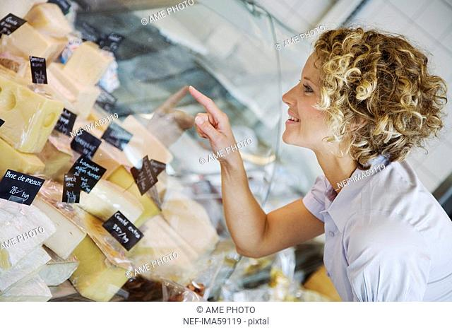 A woman buying cheese Sweden