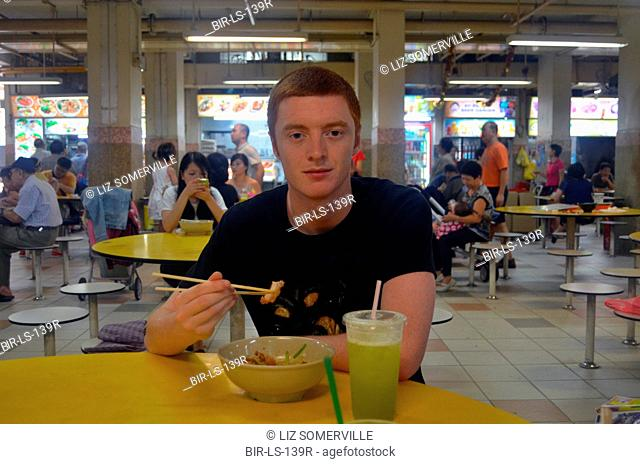 English student eating street food in Singapore 2013 - model released