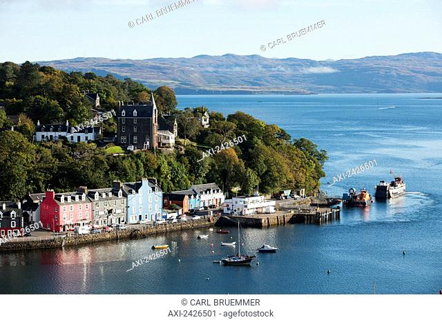 Colourful buildings and boats in a harbour; Tobermory, Isle of Mull, Hebrides, Western Isles, Scotland