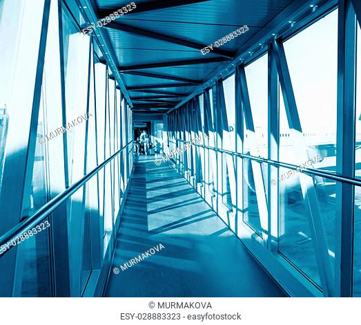 Corridor for passage to boarding in plane. Blue colored