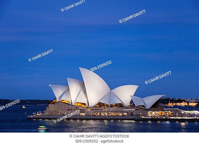 The sails of the Sydney Opera House, Designed by the Architect Jorn Utzorn at twilight,Bennelong Point, viewed from the Rocks, Sydney, New South Wales