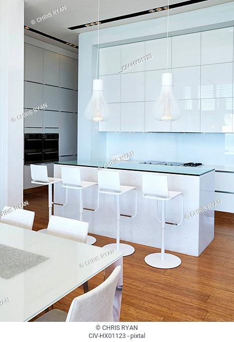 Modern white home showcase kitchen with breakfast bar