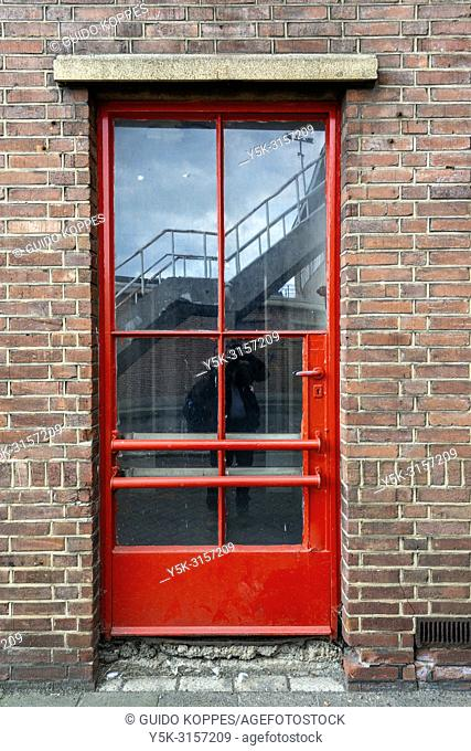 Rotterdam, Netherlands. Entrance and door, leading to an old, 1950's build industrial and harbour cantina for employees on the dock's of Merweharbours Fruit...