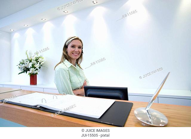 Woman at reception, smiling, portrait