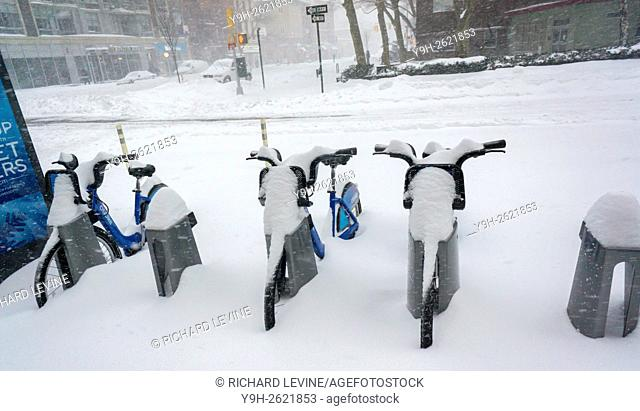 Snow covered Citi Bikes in Chelsea in New York during Winter Storm Jonas