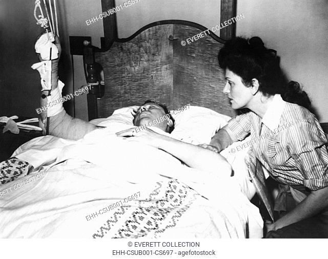 Labor Leader Walter Reuther in hospital after an attempted assassination. His wife, May Reuther, was at his hospital bedside. April 21, 1948