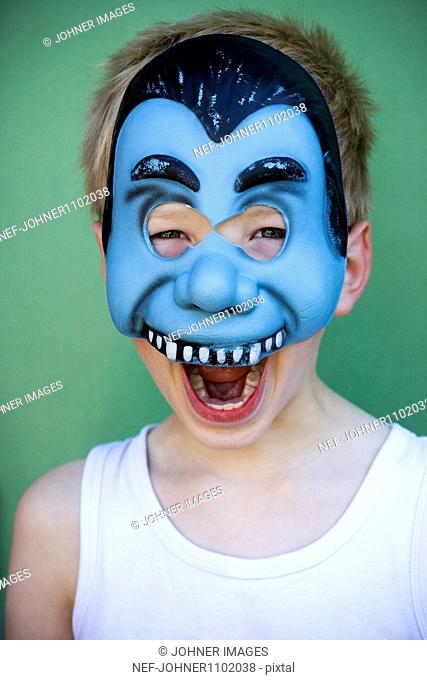 Boy wearing blue mask