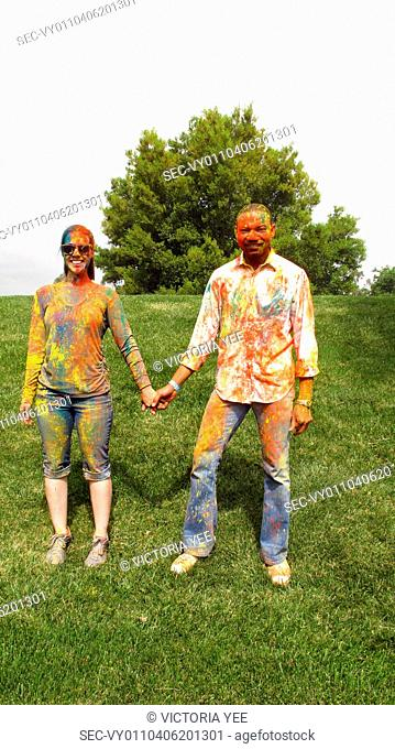 Couple covered with colorful paint