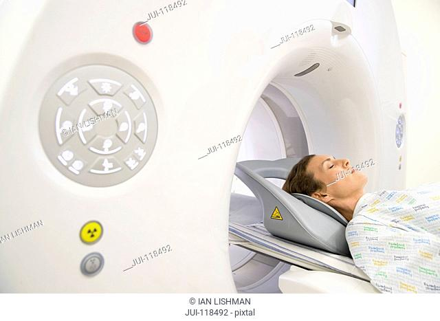 Female Patient In Hospital Radiology Unit Undergoing CT Scan