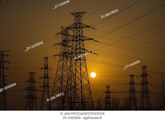 sunset and electric poles and lines