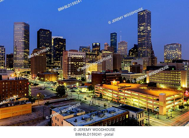 Blurred motion view of Houston cityscape illuminated at night, Texas, United States