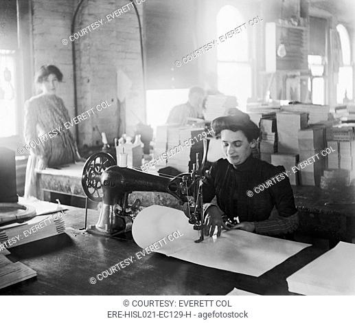 Middle-aged women sewing on a belt driven Singer machine at the Richmond & Backus Company, Detroit, Michigan, ca. 1905