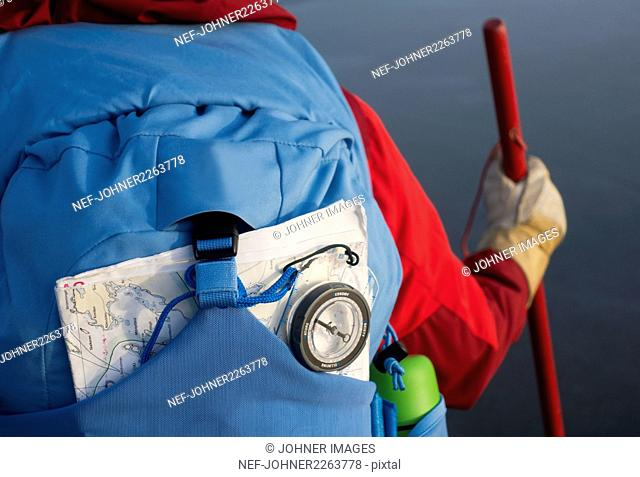 Map and compass in backpack