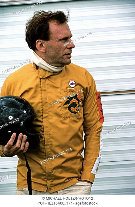 Jean-Louis Trintignant posing before a car race on the Circuit de Nevers Magny-Cours. May 3 and 4, 1975 Photo Michael Holtz
