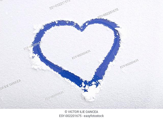Heart shape, drawn on white snow, love symbol