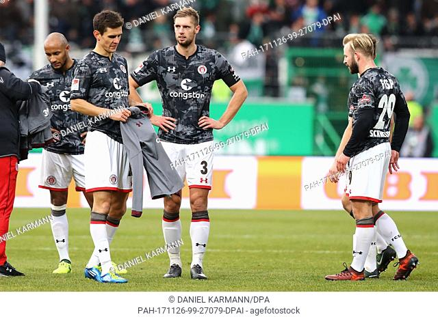 St. Pauli's Christopher Avevor (L-R), Johannes Flum, Lasse Sobiech and Jan-Marc Schneider walk across the pitch after the German Second Bundesliga soccer match...