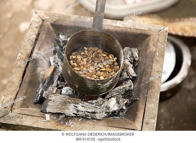 Freshly roasted coffee beans during a coffee ceremony, prepared during high-summer temperatures of 45°C in the open air, Red Sea, Massawa, Eritrea, Africa