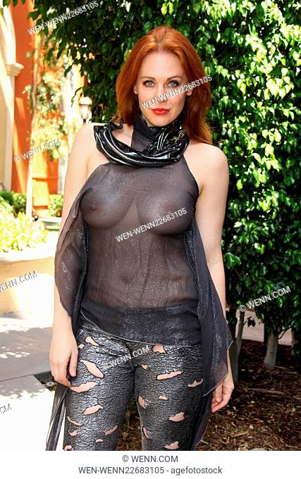 Maitland Ward bares her breasts in a completely sheer blouse while getting ready for the annual Comic-Con 'Crave Escape' party Featuring: Maitland Ward Where:...