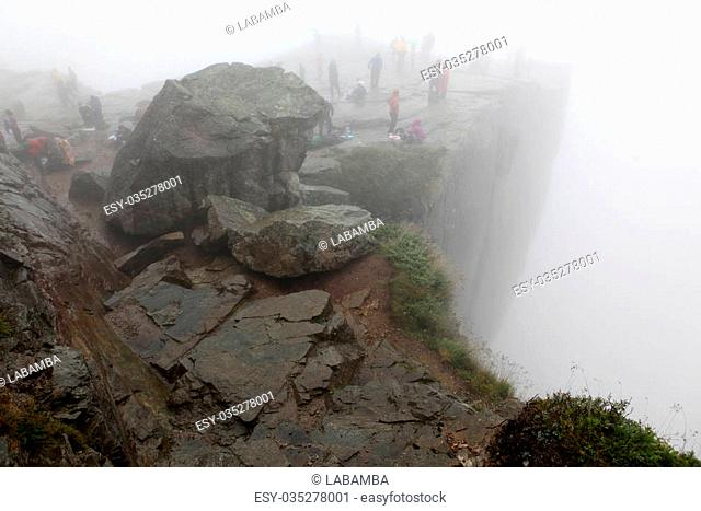 Preikestolen rock taken in deep fog, Norway fjord