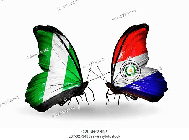 Two butterflies with flags on wings as symbol of relations Nigeria and Paraguay