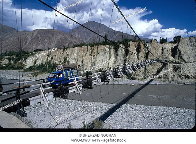 A hanging bridge over a river, in Gilgit in the northern region of Pakistan July 2, 2005