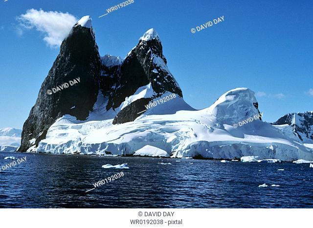 The famous ice capped 'Una's Tits' peaks at Cape Renard Cape Renard , Antarctica