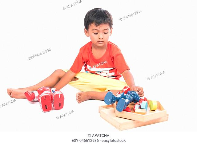 cute little boy play robot fighting
