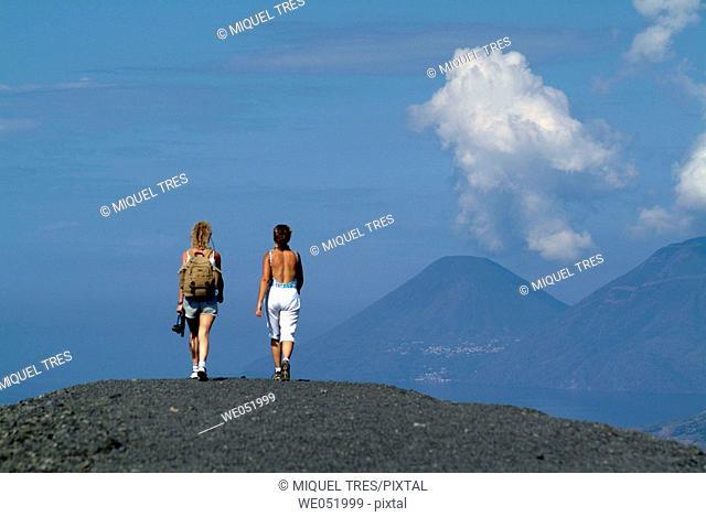 Women walking, Aeolian Islands. Italy