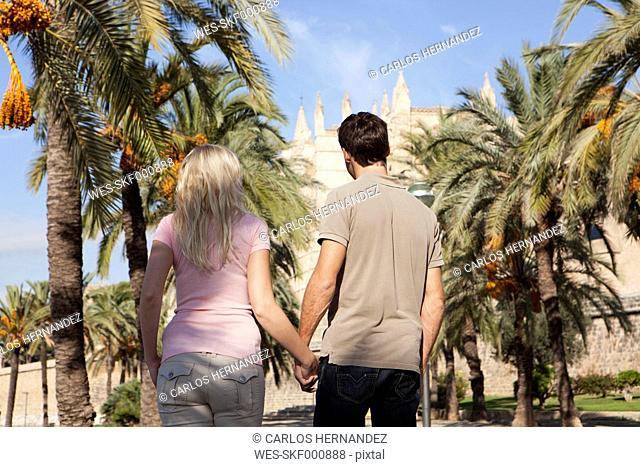 Spain, Mallorca, Palma, Couple walking along allee