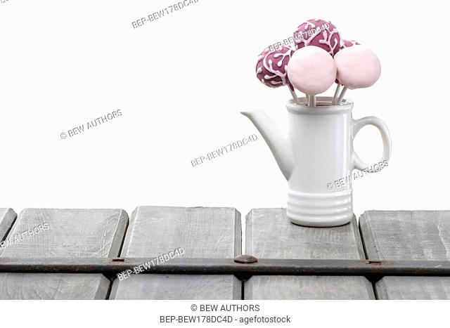 Cake pops isolated on white background. Copy space