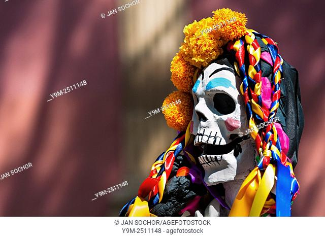 A decorated skeleton figurine is seen at the altar of the dead (altar de muertos), a religious site honoring the deceased