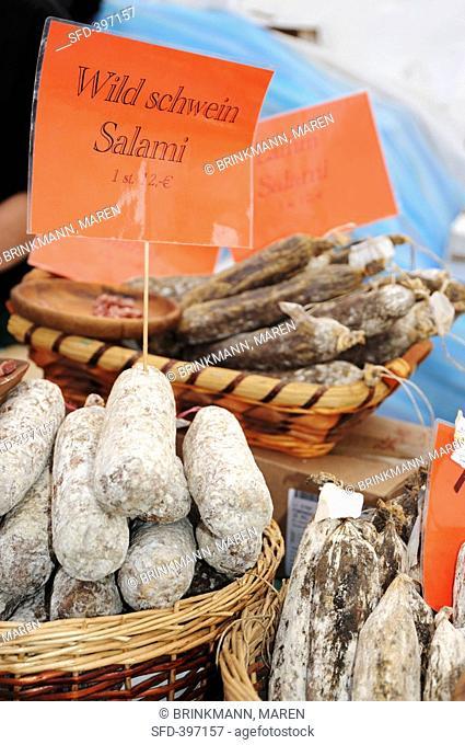 Wild boar salami on a market stall