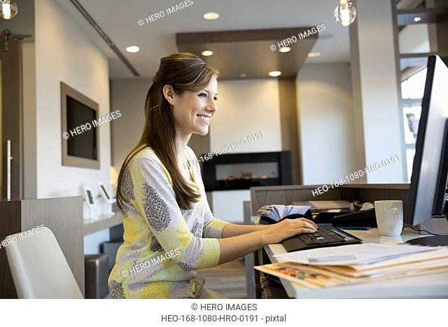 Receptionist working at computer in dentists office