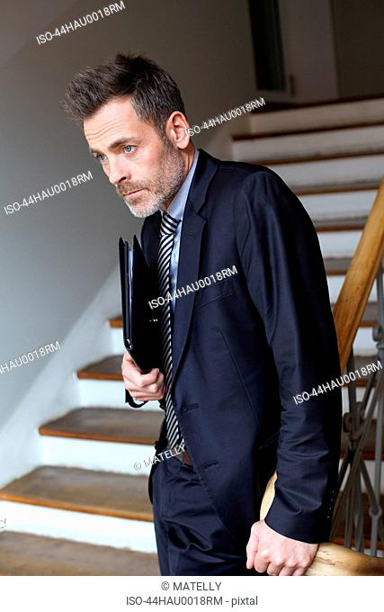 Businessman standing on steps