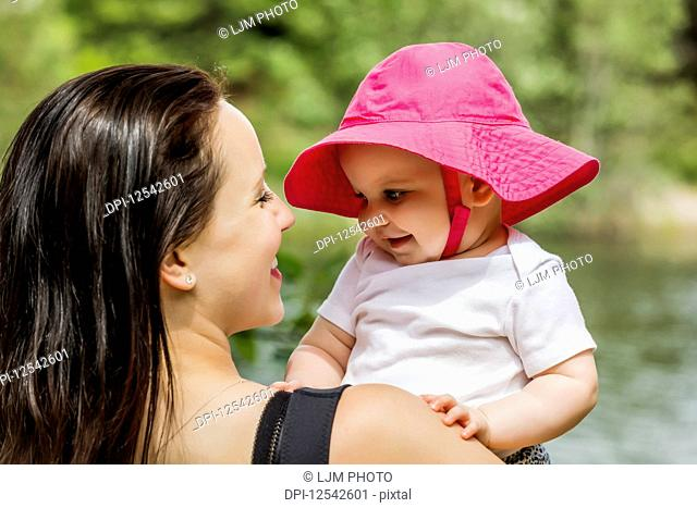 A young mother spending quality time with her daughter in a park during the summer; Edmonton, Alberta, Canada