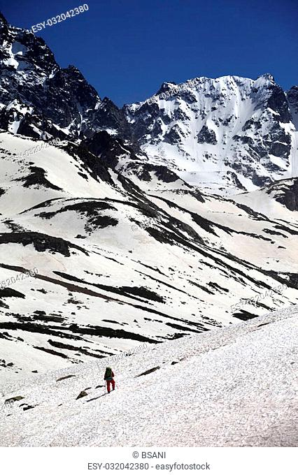 Hiker in snowy mountains. Turkey, Kachkar Mountains, highest part of Pontic Mountains